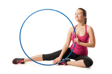 isolated portrait of young blonde woman gymnast with hula hoop
