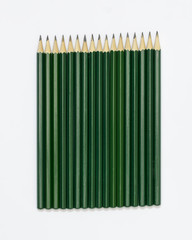 Isolated arrangment of green pencils.