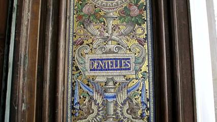 Old mosaics on le Bon Marche building in Paris France