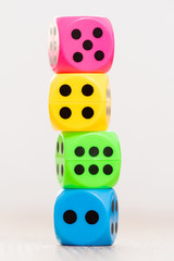 Colorful dice isolated on blurry background