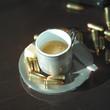 Leinwanddruck Bild - Coffee and Bullets