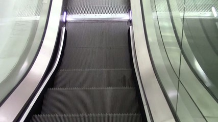 Escalator of a shopping mall , point of view
