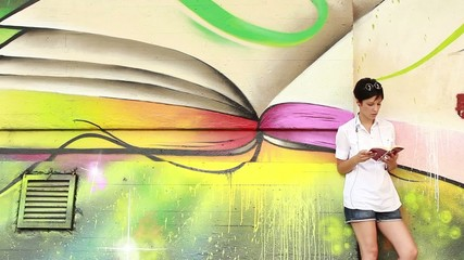 Pretty girl reading a book,abstract background,scenic
