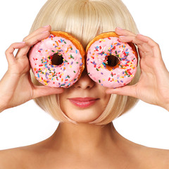 Blonde woman with colorful donuts isolated on white