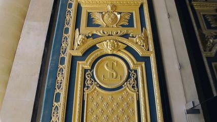 Golden door detail of L'Hotel national des Invalides, Paris