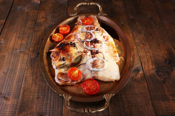 Dish of Pangasius fillet with spices and vegetables in metal