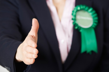 Close Up Of Female Green Party Politician Reaching Out To Shake