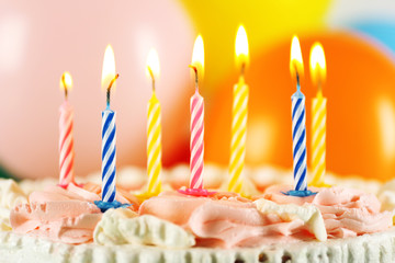 Delicious birthday cake on bright background