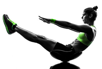 woman fitness  crunches exercises silhouette