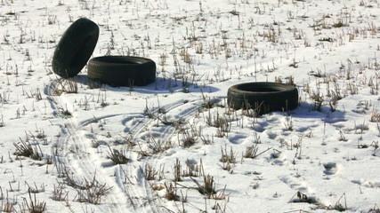 Winter tire rolls on a snowy field