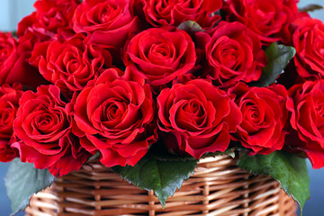 Bouquet of red roses in basket close up