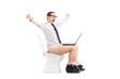 Joyful guy working on laptop in a toilet