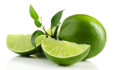 Juicy lime with green with leaves isolated on white