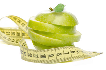 Sliced Green Apple and tape measure
