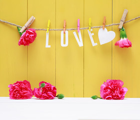Hanging Love letters with carnation flowers