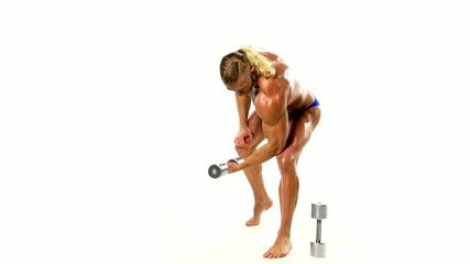 Young athlete trains biceps silver dumbbells