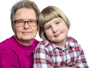 Granddaughter sitting on lap of grandmother