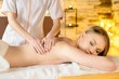 Woman getting recreation massage in spa salon