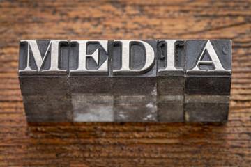 media word in metal type