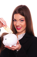 Young brunette put two-hundred Euro bill in the piggy bank