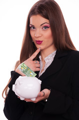 Conceived womanwith piggy bank