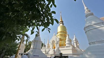 Dolly shot of golden pagoda at Suandok temple Chiangmai