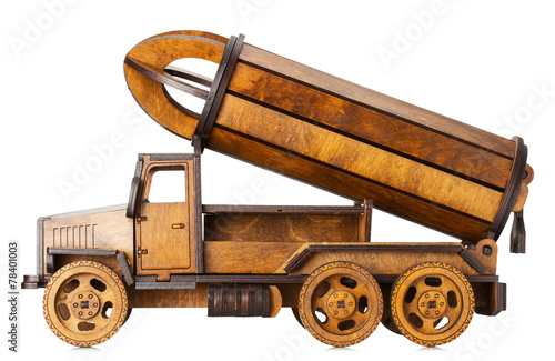 wooden model of car with rocket isolated on the white background - 78401003