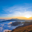 sunset over a misty mountains
