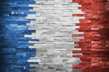 French flag painted in a brick wall