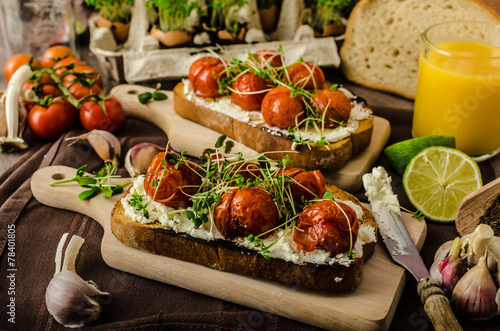 Foto op Aluminium Snack Roasted Cherry Tomato Sauce and Ricotta on Toast