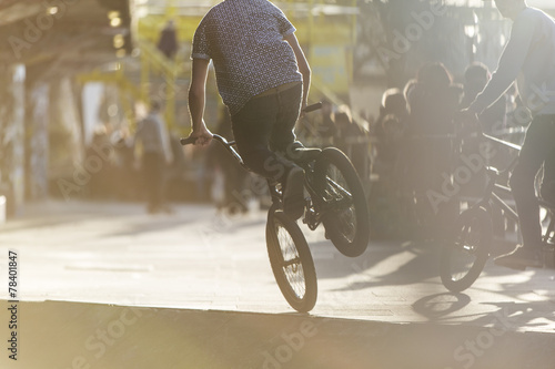 Anonymous bmx biker doing a stunt - 78401847