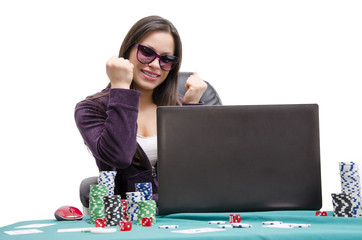 Young woman playing poker online success