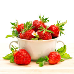 strawberries with fresh green leaves and flowers