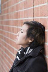 Young Attractive Asian American Woman Brick Wall