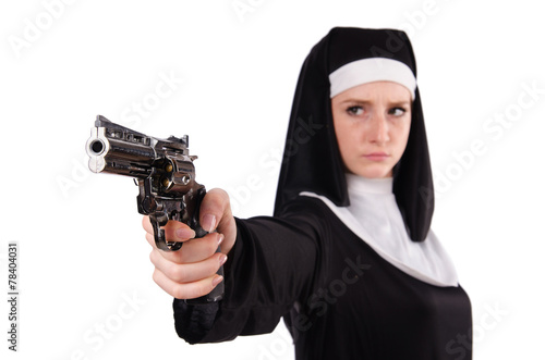 canvas print picture Aiming young nun with gun isolated on white
