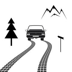 Car driving on a mountain road with tire tracks