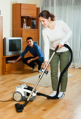 Ordinary couple doing housework together
