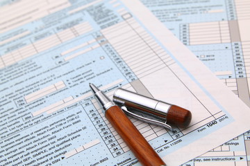 1040 Income tax form and pen. Finance concept