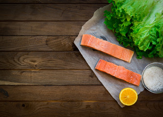 Raw salmon on wooden table