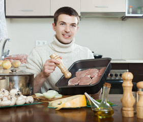 man cooking  meat