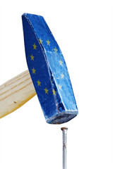 hammer with flag of the european union hitting a rusty nail,  me