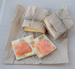 Homemade crackers with a salmon