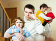 Couple with children in quarrel at home