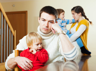 Young family after quarrel at home