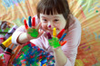 canvas print picture - Cute little girl with painted hands