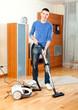 Ordinary guy  vacuuming