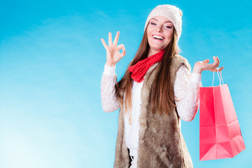 Winter girl with red paper shopping bag