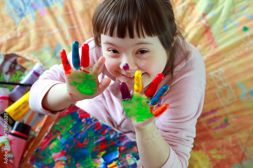 canvas print picture Cute little girl with painted hands