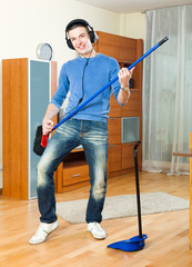 Young man  with dustpan and brush