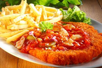 Tasty Crumbled Zigeunerschnitzel Paired with Fries